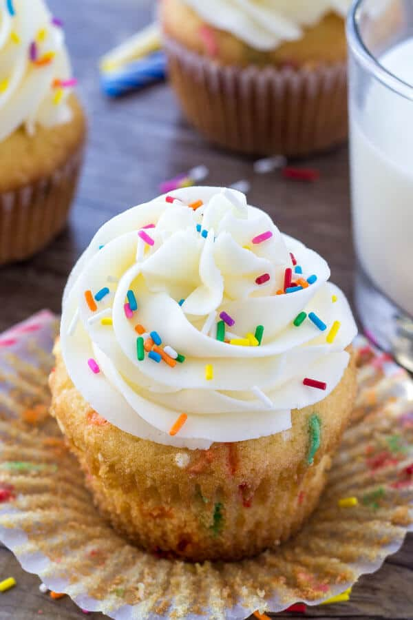 Homemade funfetti cupcakes are the ultimate dessert for birthdays and celebrations. Light and fluffy, filled with sprinkles and piled high with frosting - this recipe is way better than any boxed mix!