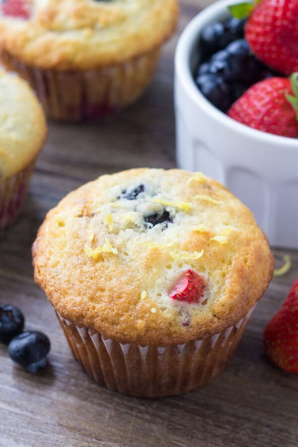 Triple Berry Muffins. Moist, fluffy, buttery & bursting with berries - make them with fresh or frozen fruit - they're always a hit! www.justsotasty.com