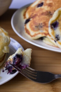 Blueberry Buttmilk Pancakes. Light, fluffy and bursting with blueberries - these pancakes are so much better than any mix!