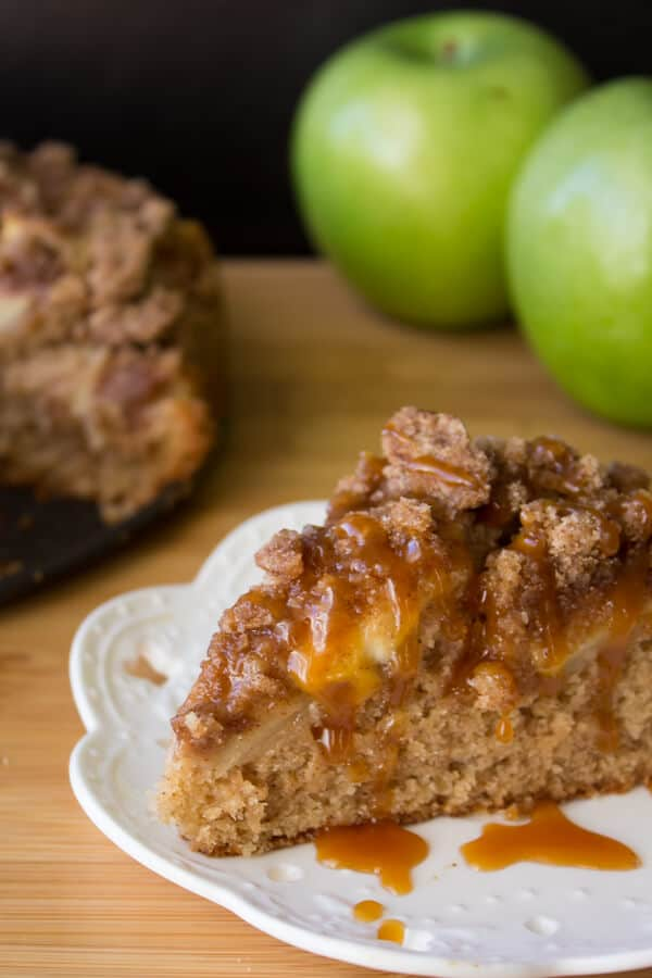 Caramel Apple Cinnamon Coffee Cake. With apples, a super soft crumb, cinnamon streusel topping & a drizzle of salted caramel - perfect for fall!