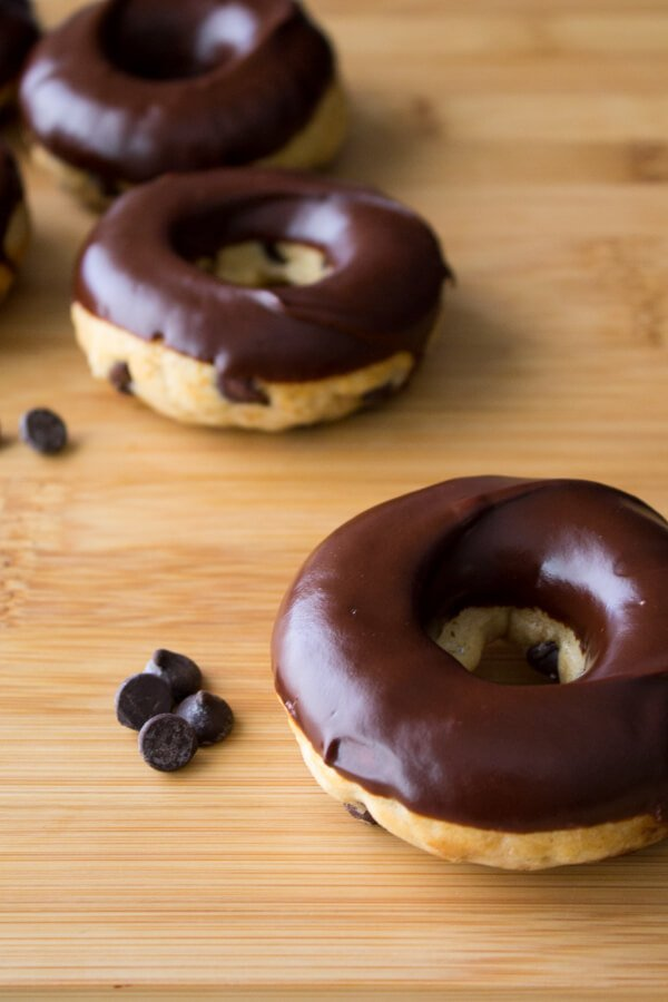 Chocolate Chip Doughnuts. Cake doughnuts baked in a doughnut pan, filled with chocolate chips & dipped in chocolate glaze - Say hello to your new favorite breakfast!