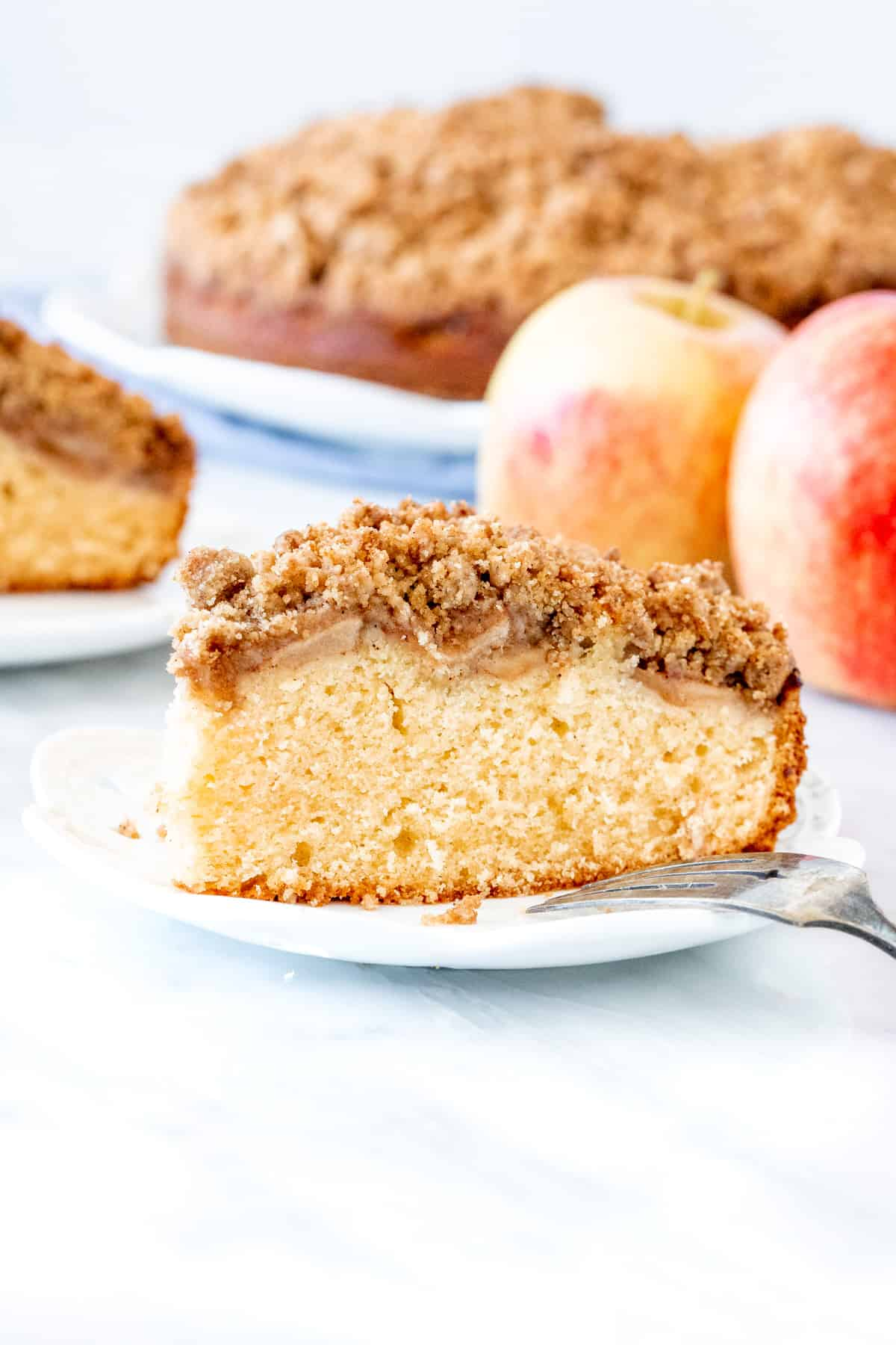 Slice of apple cake with streusel topping