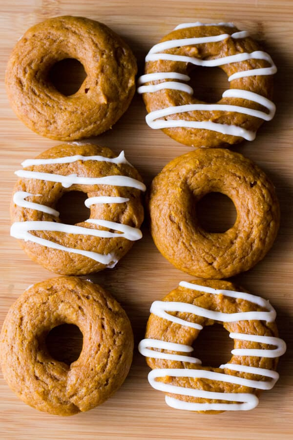 Baked Pumpkin Cake Doughnuts with Cream Cheese Glaze are the perfect fall treat. Ready in 30 minutes from start to finish - try them for breakfast or afternoon coffee!