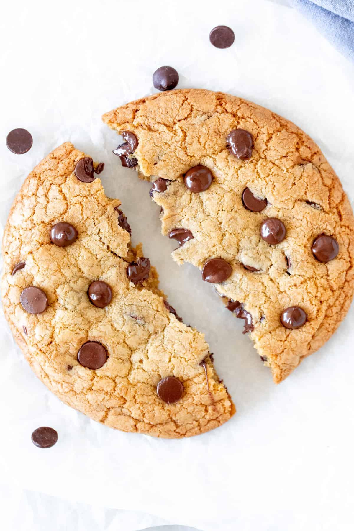 Single serving chocolate chip cookie broken in half