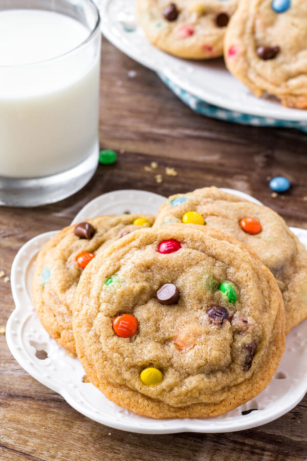 M&M Cookies are soft, chewy & filled with chocolate chips and rainbow candies. You'll love this easy, no chill cookie recipe.