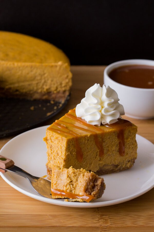 Smooth & creamy Pumpkin Cheesecake with a cinnamon graham cracker crust, delicious spices, the perfect pumpkin flavor & drizzled with salted caramel sauce. With lots of baking tips included - try this perfect recipe for fall!
