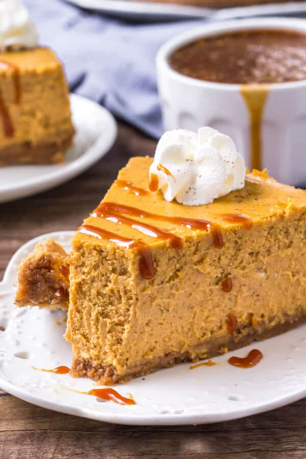 Pumpkin pie cheesecake with a drizzle of salted caramel sauce - the perfect Thanksgiving dessert.
