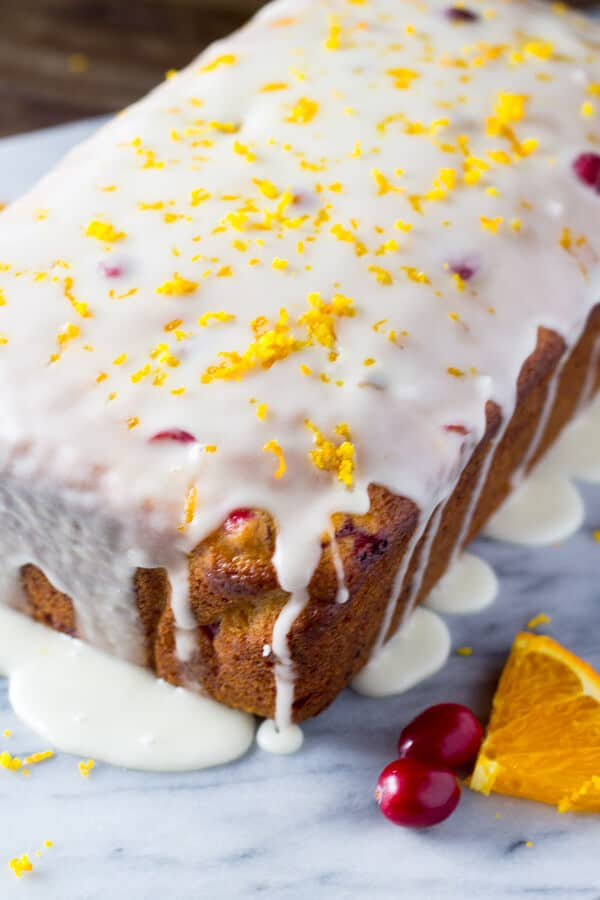 Glazed Cranberry Orange Loaf. Super soft & moist because it's made with sour cream - be sure to include this recipe in your holiday baking check list! www.justsotasty.com