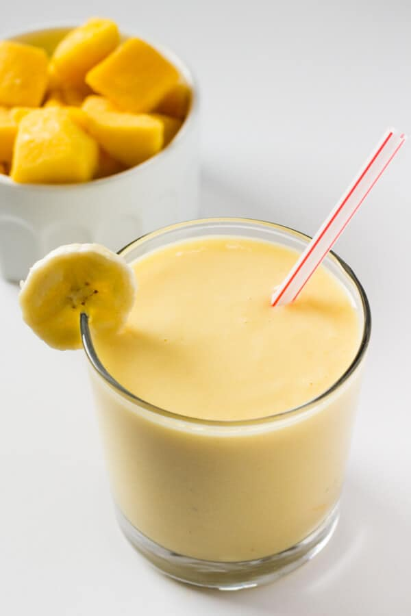 Thick, tropical & full of sunny fruit flavors to brighten even the dreariest of days - Make this Mango Fruit Smoothie for the perfect healthy pick-me up!