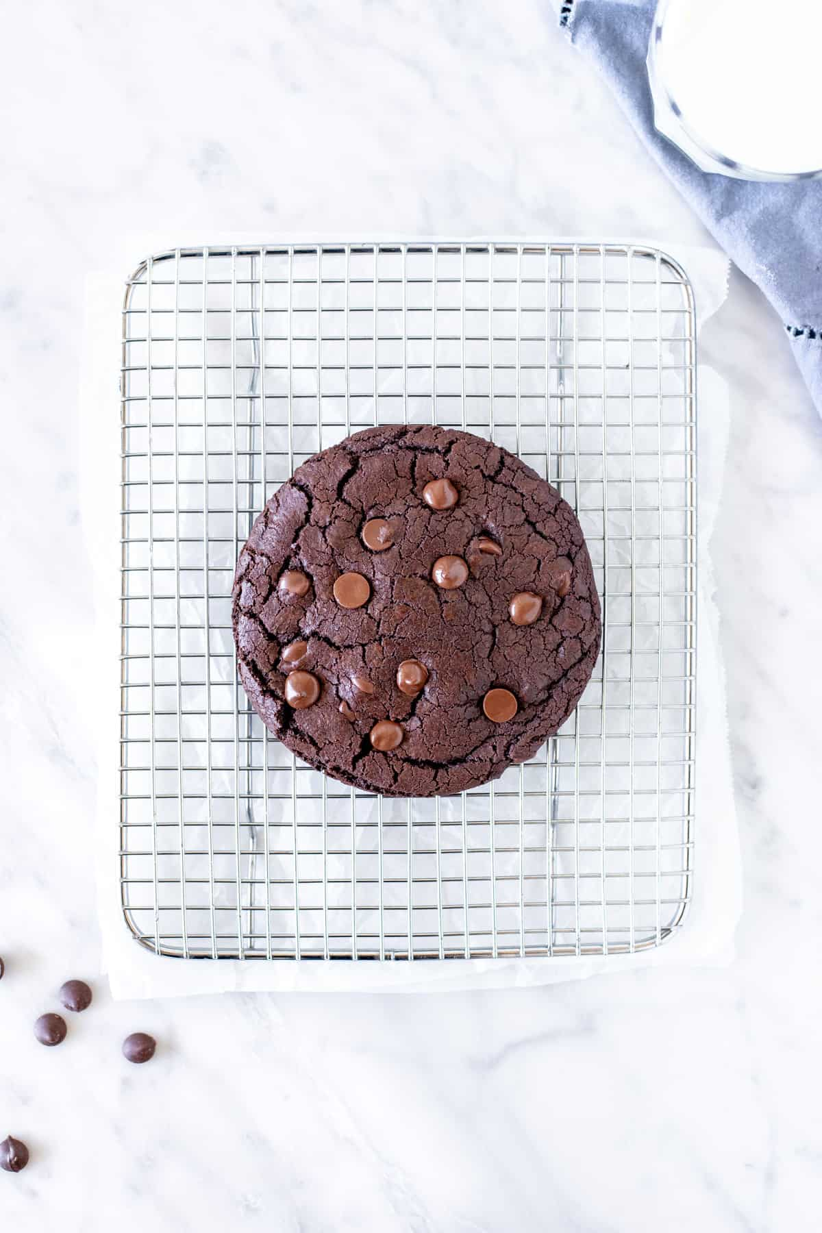 Very large chocolate cookie on a cooling rack