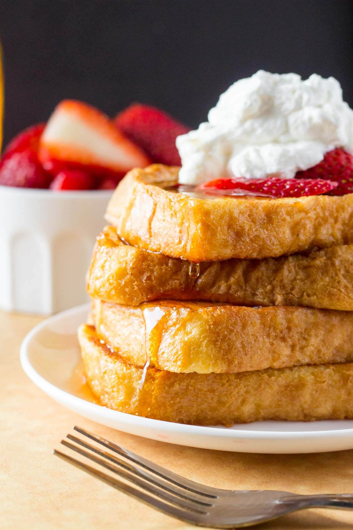 The Best French Toast. Fluffy and buttery with perfectly golden edges and a hint of cinnamon. The PERFECT comfort food. www.justsotasty.com