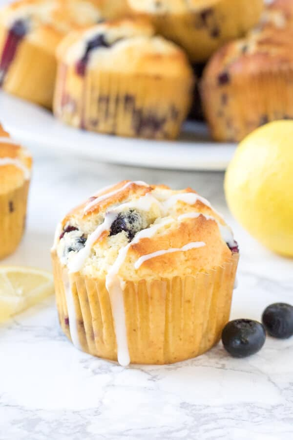 Lemon blueberry muffins that are moist & fluffy. They have a soft & fluffy texture, delicious lemon flavor & tons of juicy berries.
