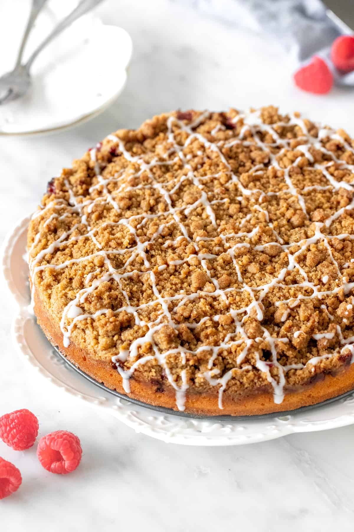 9-inch round coffee cake with drizzle of glaze on top.