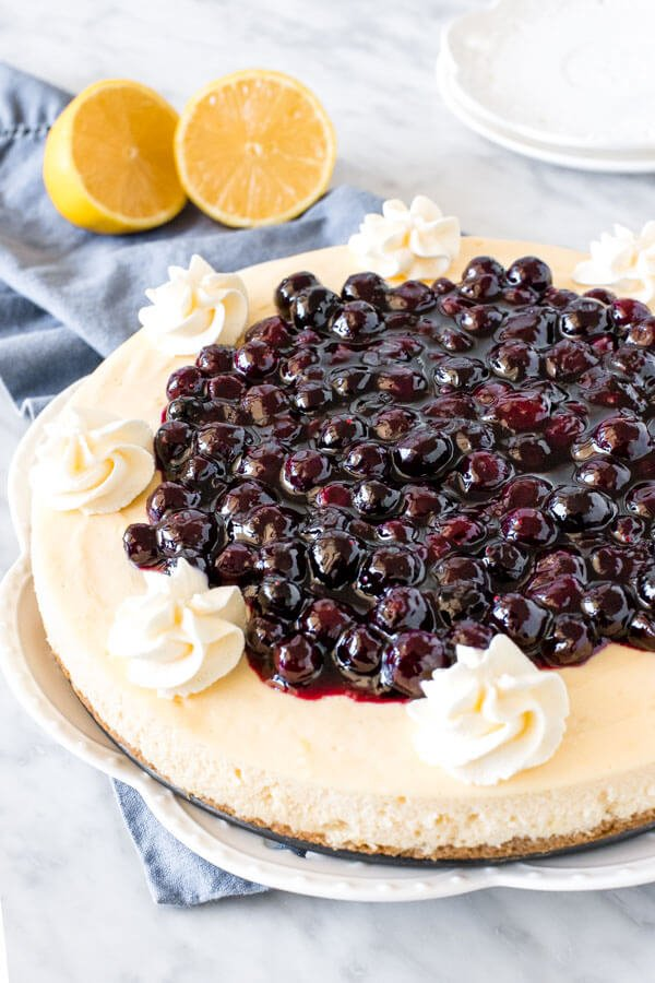 Entire round cheesecake with blueberry topping.