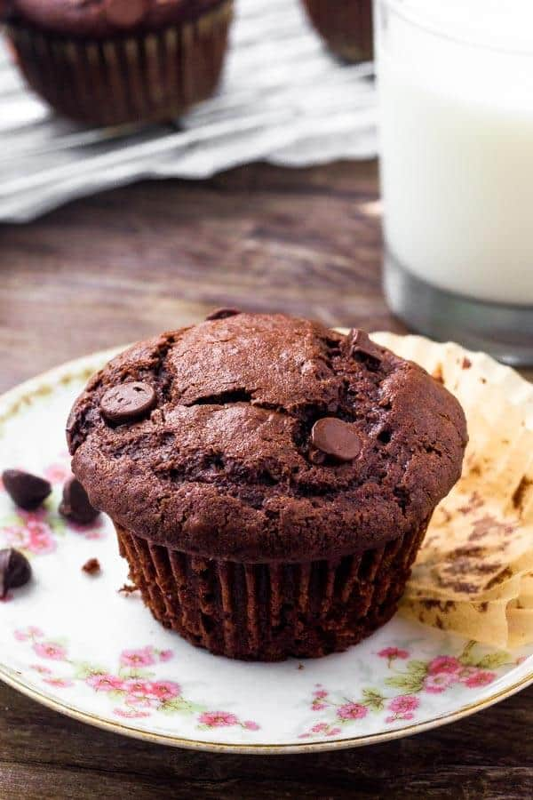 Extra moist double chocolate muffins are everything you could want in a muffin. They have slightly crunchy tops with deliciously tender centers that filled with melted chocolate.