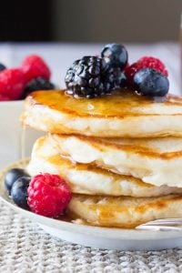 The softest, most fluffy Buttermilk Pancakes imaginable. Perfectly golden edges & designed for soaking up lots of maple syrup - these are the BEST pancakes you'll ever eat!