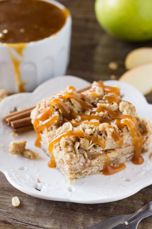 These no-mixer Apple Oatmeal Crumb Bars are perfect for fall. Filled with oatmeal, brown sugar, & cinnamon apples - have them with ice cream & caramel for dessert, then the leftovers for breakfast!
