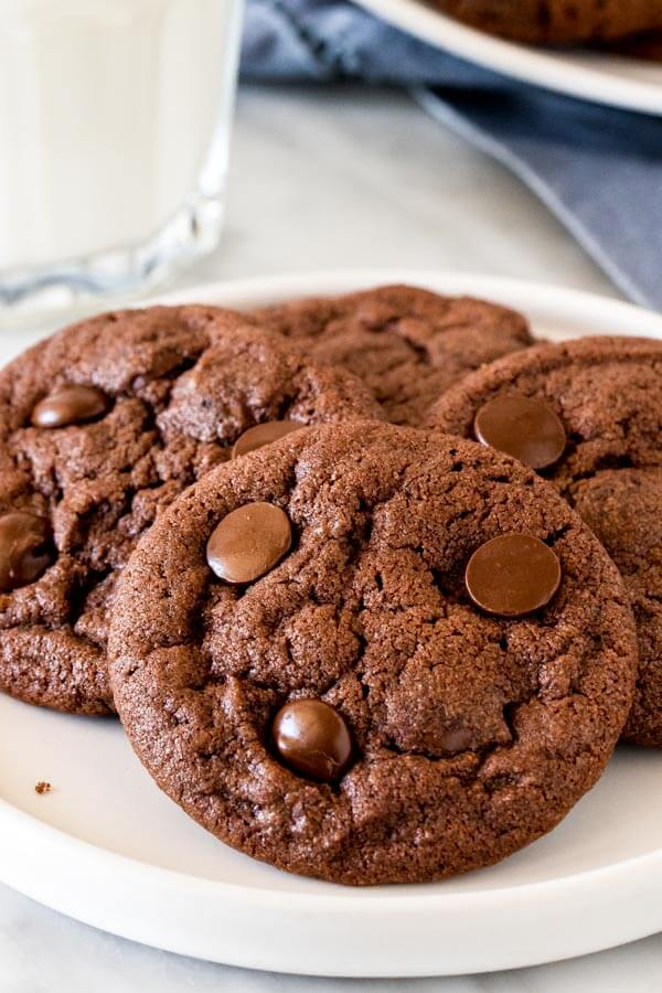 Plate of nutella chocolate chip cookies with a glass of milk.