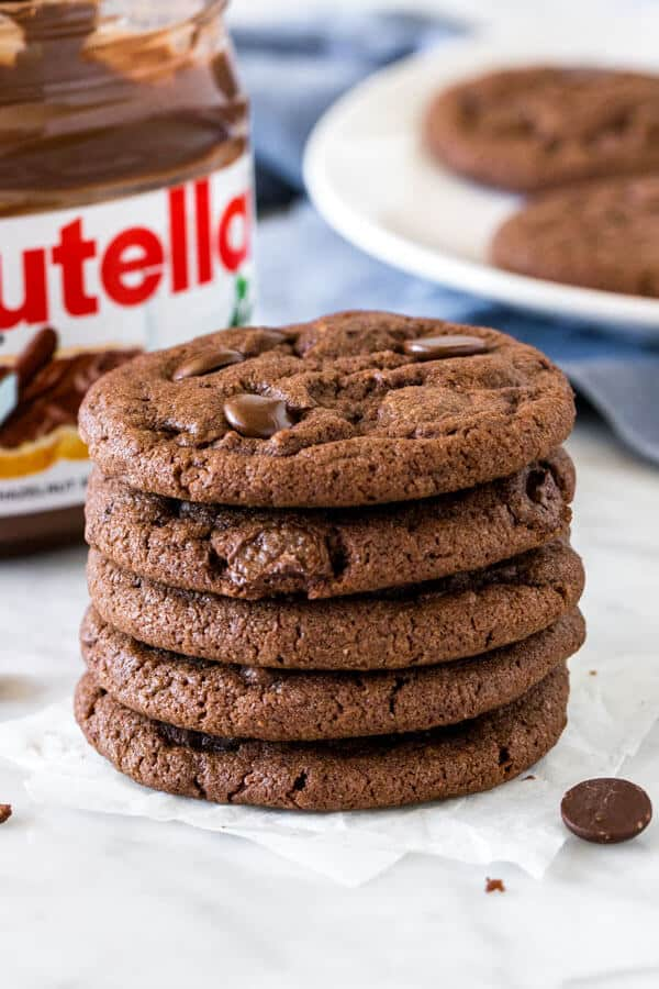 Stack of Nutella cookies with jar of nutella