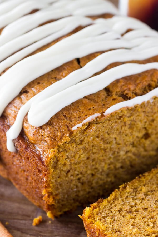 Pumpkin Bread with Cream Cheese Glaze. Soft, moist & filled with vanilla & spices - this pumpkin bread is perfect for fall! www.justsotasty.com