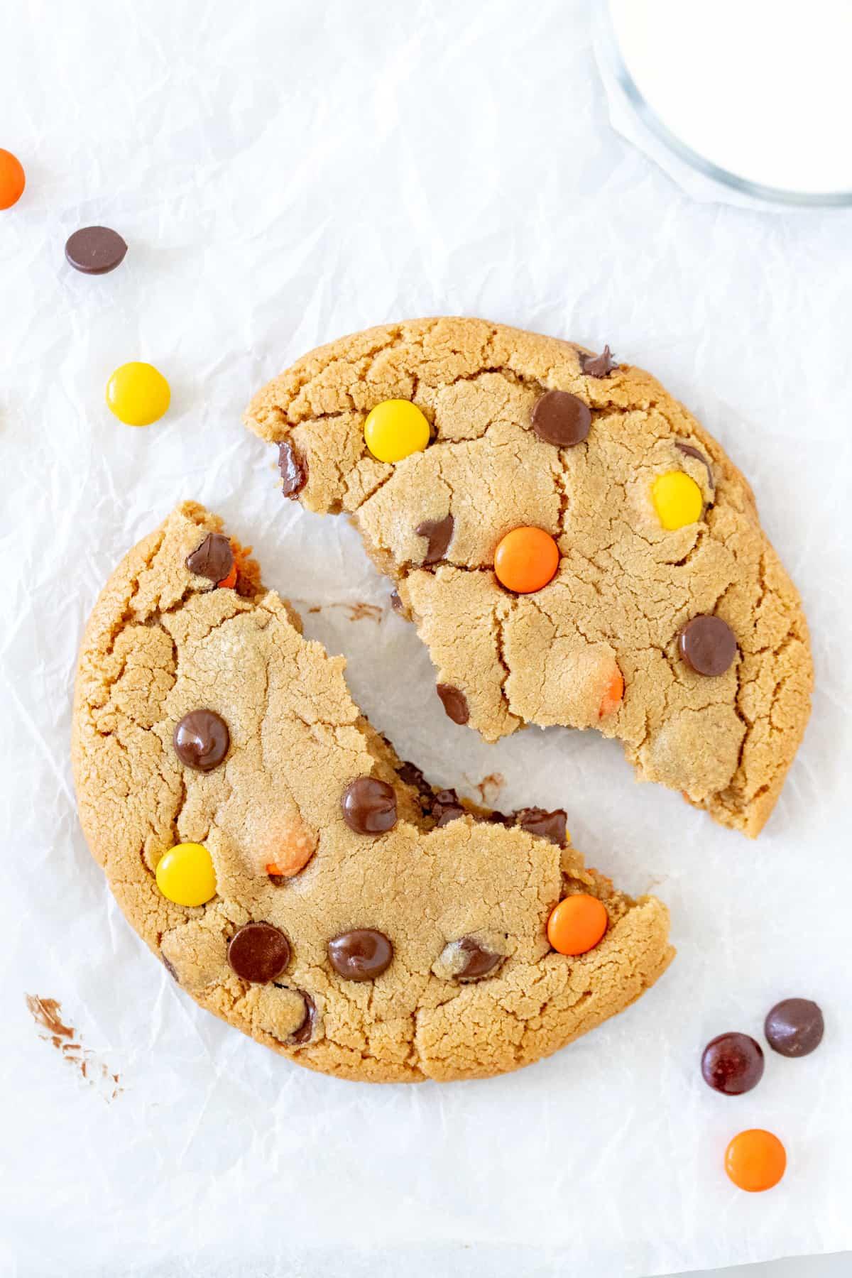 Peanut butter cookie for one, broken in half