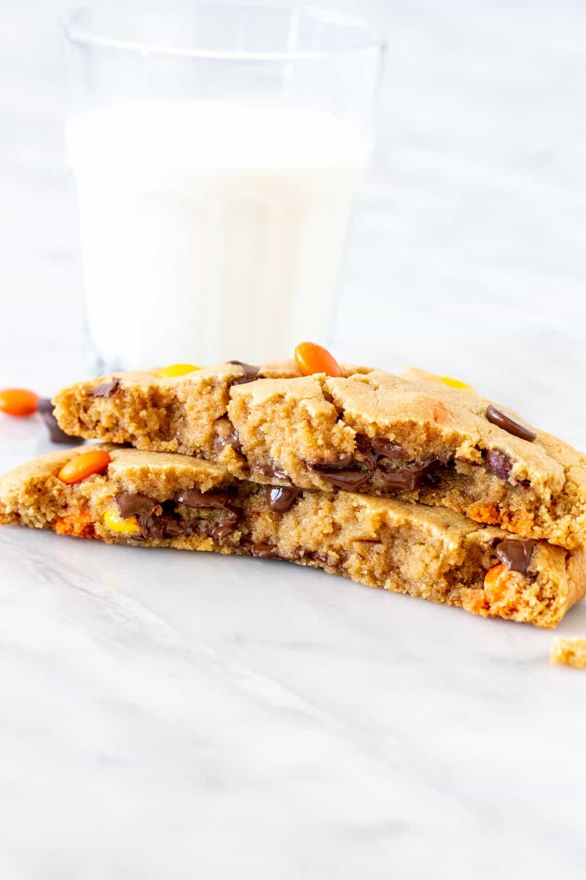 Single serving peanut butter cookie broken in half.