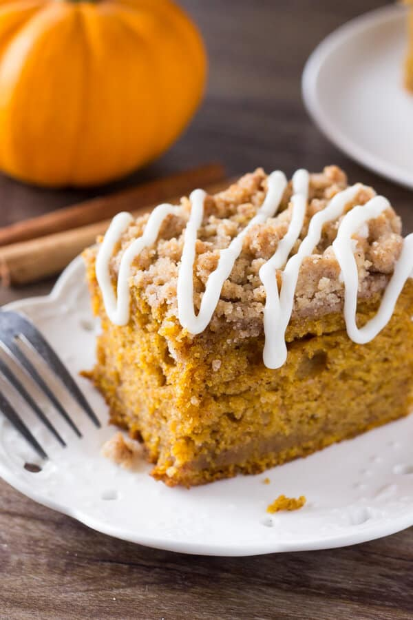 Pumpkin coffee cake is extra moist and filled with pumpkin spice. Then it's topped with crunchy streusel and vanilla glaze.
