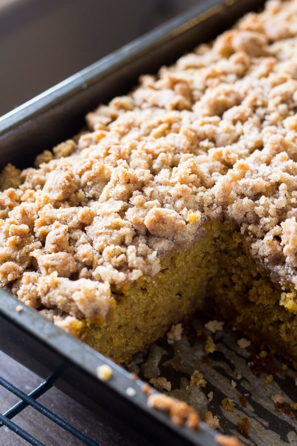 Pumpkin, spice & everything nice come together in this easy Pumpkin Coffee Cake with streusel topping. Made with sour cream so it's super moist - this pumpkin crumb cake is perfect for fall!
