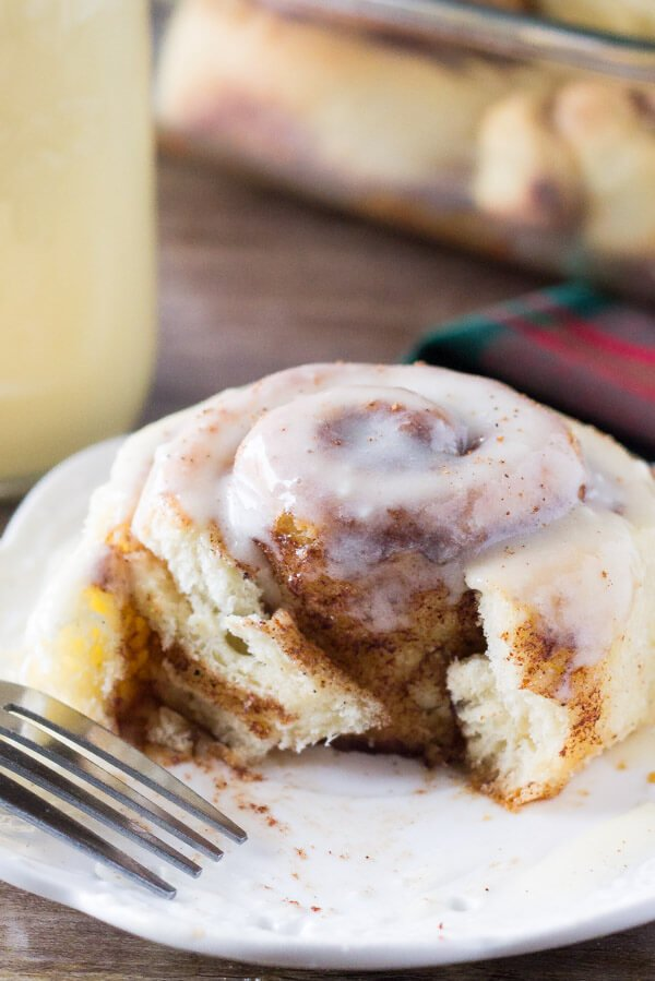 Eggnog Cinnamon Rolls. These super fluffy cinnamon buns are made with eggnog, filled with spices, and drizzled with eggnog glaze. Prepare the buns overnight, then wake up to cinnamon rolls! www.justsotasty.com