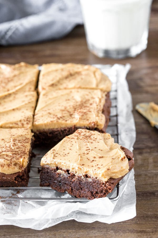 A cooling rack with a pan of coffee brownies with coffee frosting