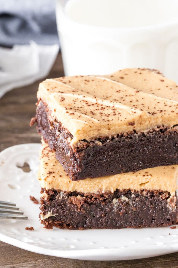 2 mocha brownies with cafe latte frosting stacked one on top of each other