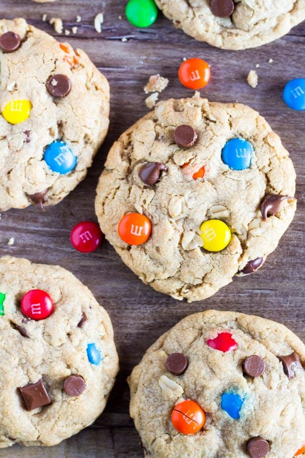 Soft and Chewy Monster Cookies. These ginormous cookies are filled with peanut butter, chocolate chips, oatmeal AND M&Ms. Seriously... everything you could ever want in a cookie! www.justsotasty.com