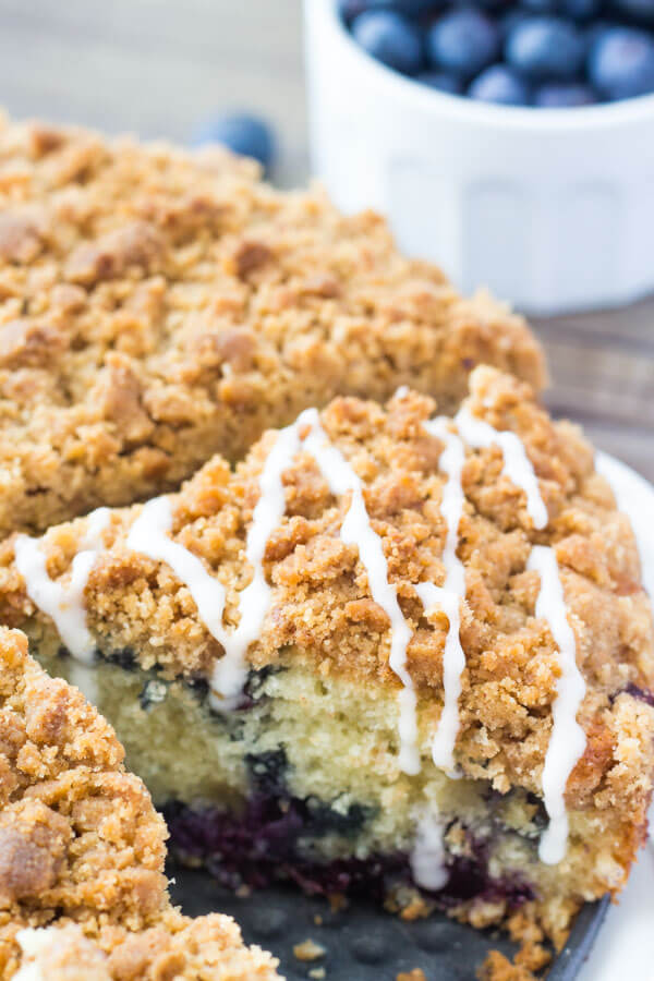 Blueberry Coffee Cake.Fluffy, buttery Blueberry Coffee Cake with Streusel Topping. Bursting with fresh berries, perfectly moist & perfect for spring! From Just So Tasty www.justsotasty.com
