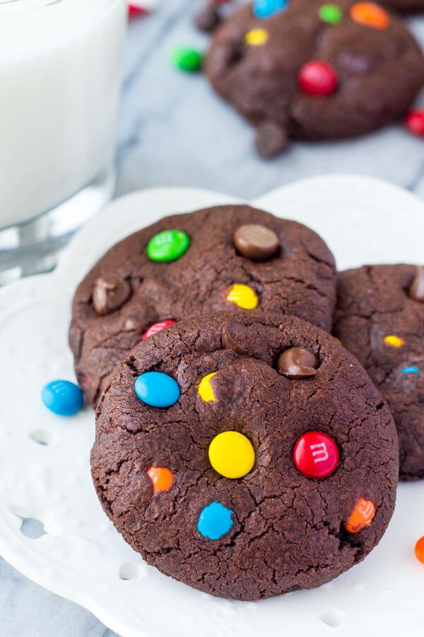 M&M Double Chocolate Cookies. Fudgy, chewy, super soft - the perfect M&M chocolate chip cookies for true chocolate lovers! www.justsotasty.com
