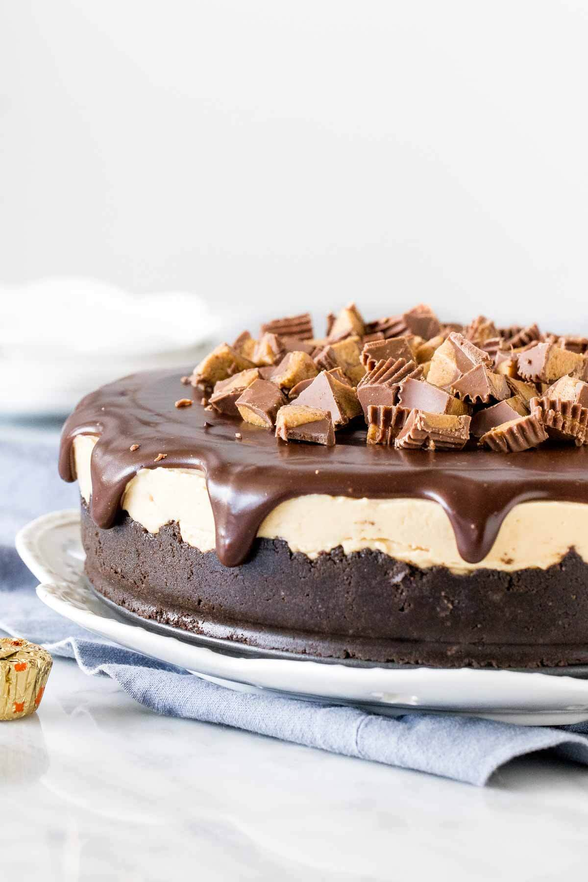 Peanut butter cheesecake with chocolate topping and peanut butter cups.