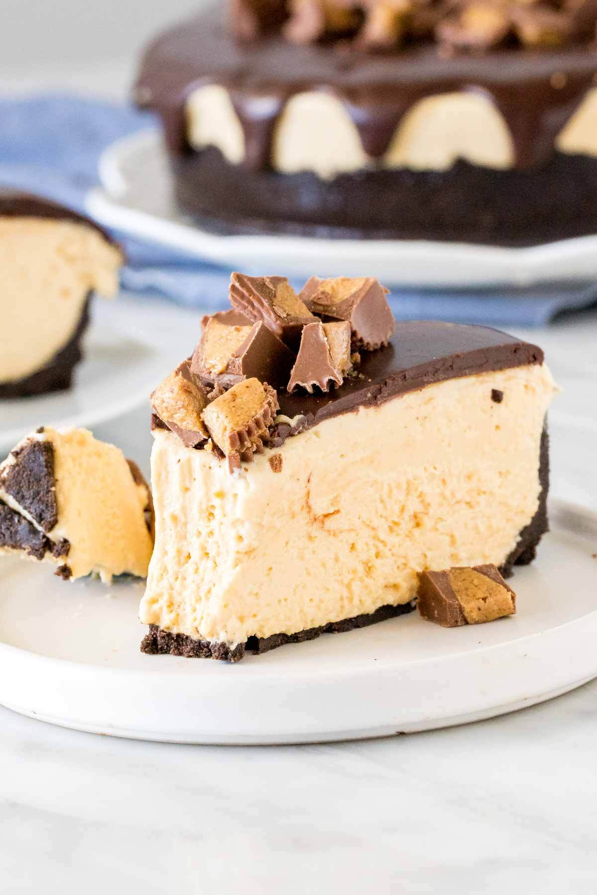 Slice of peanut butter cheesecake with a bite taken out of it.