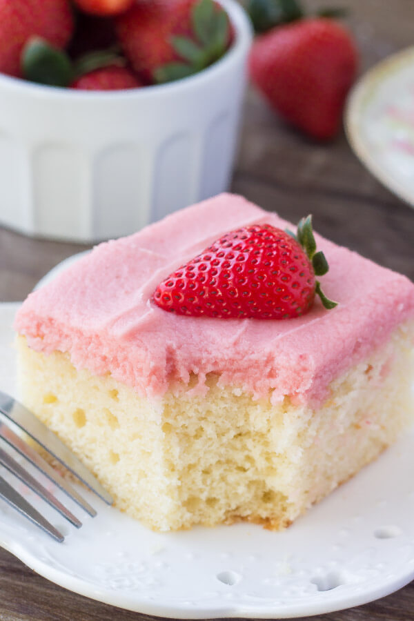 Fluffy, buttery Vanilla Cake with Strawberry Frosting. You'll love the moist, soft cake crumb & the fresh strawberry flavor of the frosting! www.justsotasty.com