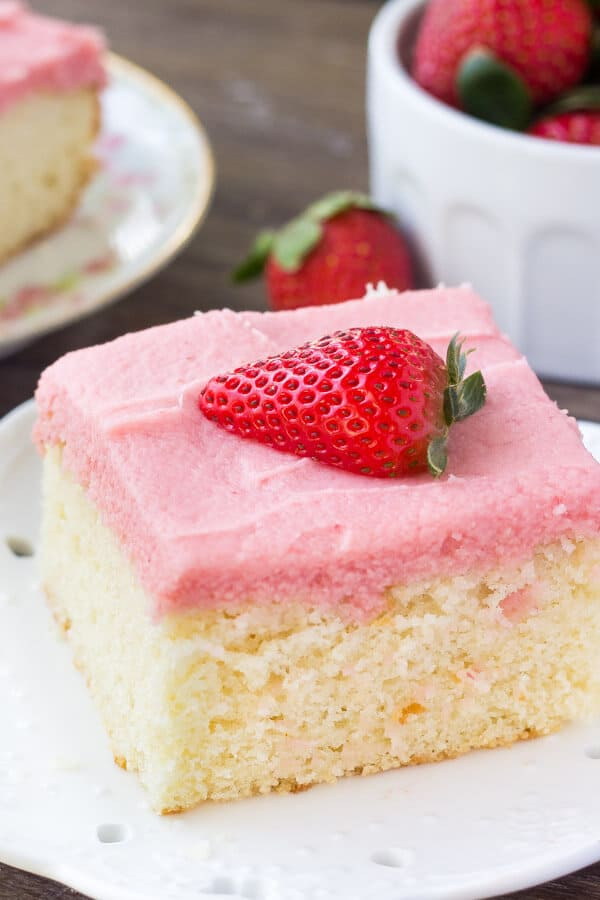 Fluffy, buttery Vanilla Cake with Strawberry Frosting. You'll love the moist, soft cake crumb & the fresh strawberry flavor of the frosting!