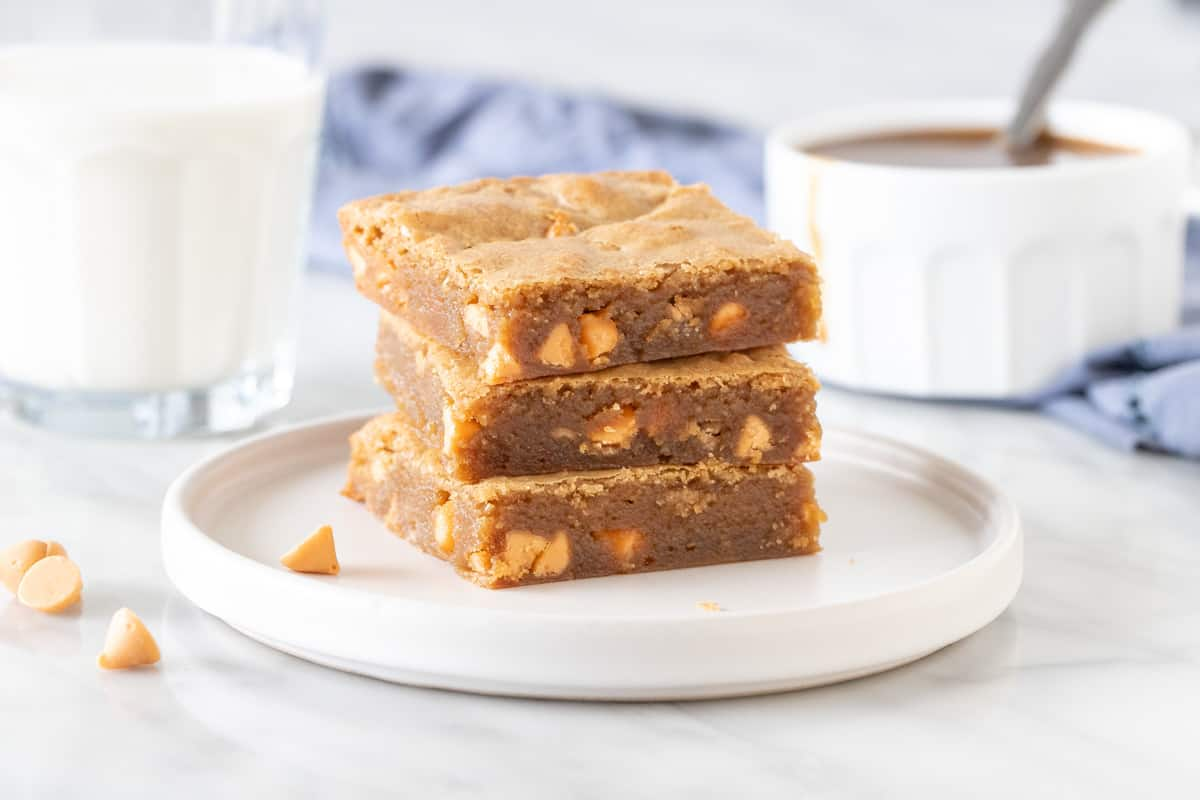 Stack of 3 blondies made with butterscotch chips.