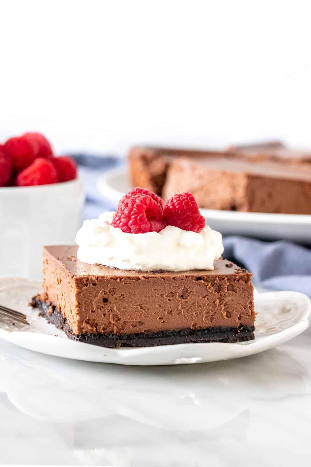 Slice of chocolate cheesecake bars on a plate.