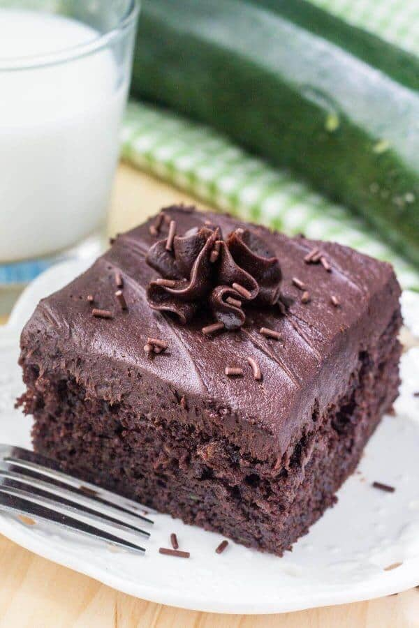 This double chocolate zucchini cake is super moist with a delicious chocolate flavor and creamy chocolate frosting. You'll never guess that there's zucchini in it