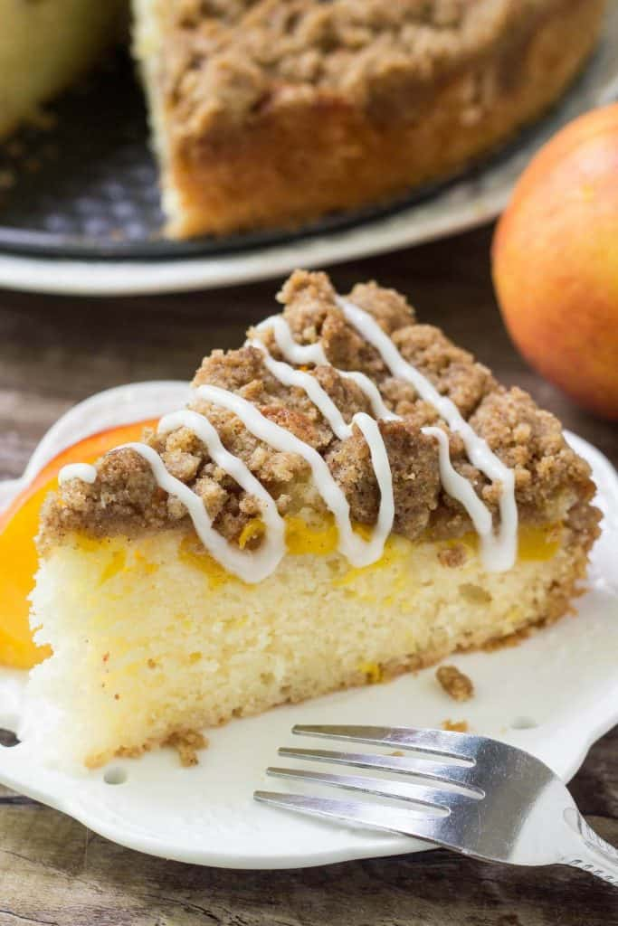 This peach coffee cake is deliciously moist with the perfect sponge cake texture. Then there's a layer of juicy peaches and cinnamon brown sugar streusel topping.