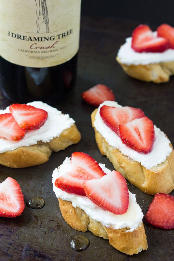 #ad These goat cheese crostini with fresh berries & honey are the perfect appetizer. They're light & fresh with creamy goat cheese and perfect for a casual get together. #sharewineandbites #ad