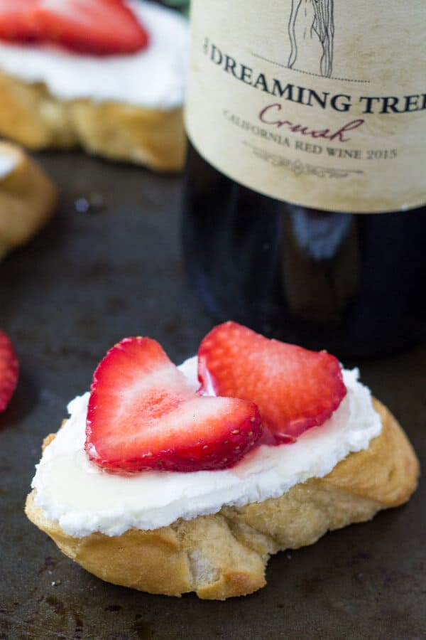 Msg 4 21+ These goat cheese crostini with fresh berries & honey are the perfect appetizer. They're light & fresh with creamy goat cheese and perfect for a casual get together. #sharewineandbites #ad