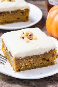 This Pumpkin Cake with Maple Frosting starts with a super moist, cinnamon packed pumpkin sheet cake. Then it's topped with fluffy, creamy maple buttercream made with real maple syrup.