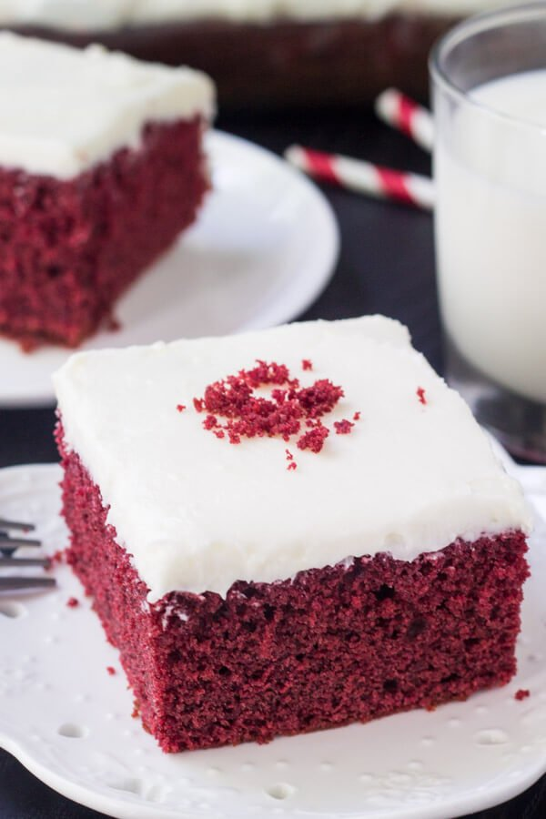 This easy red velvet cake is the perfect recipe. Extra moist with the most delicious red velvet flavor and fluffy cream cheese frosting. It'll be your new favorite.