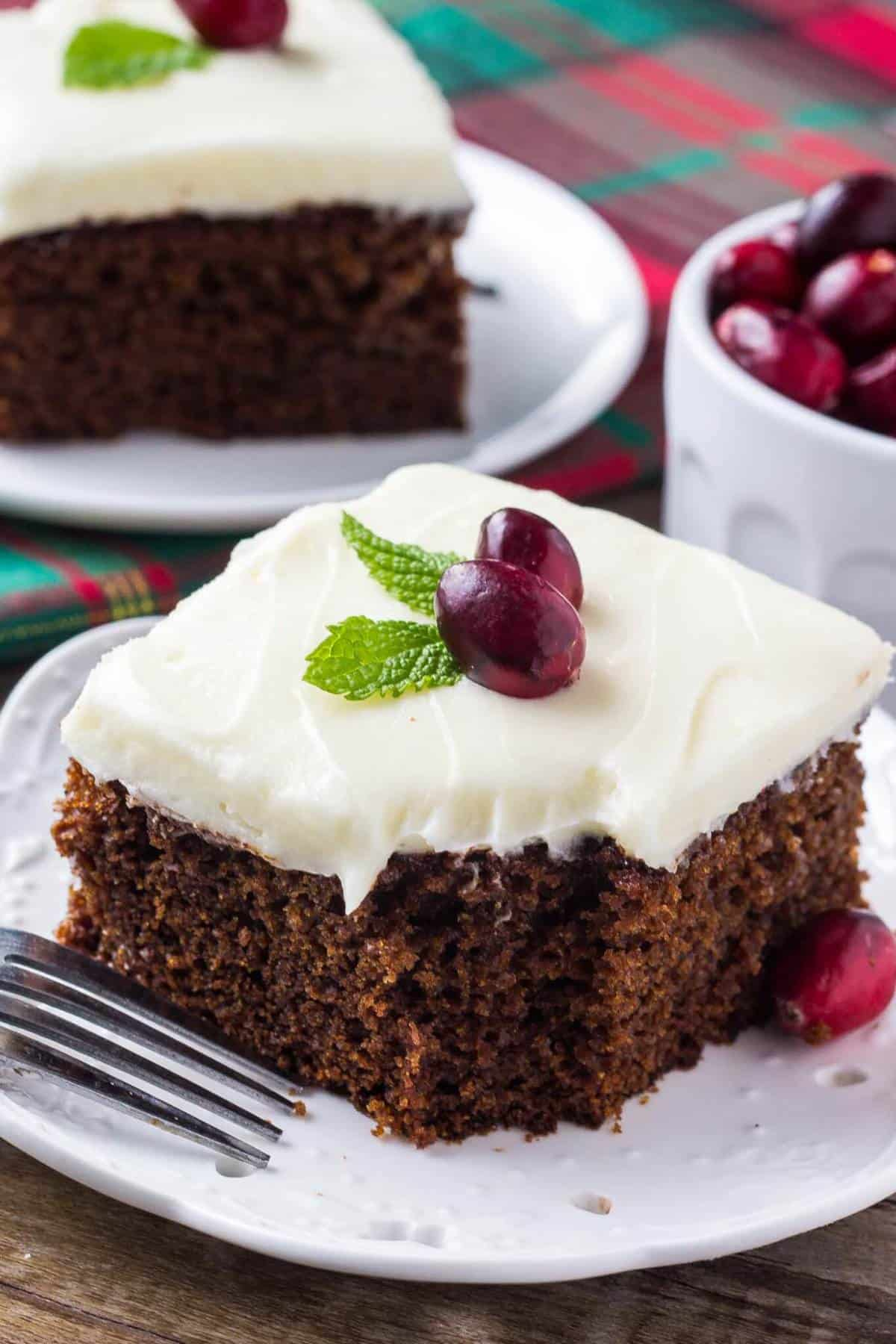 This super moist, spiced gingerbread cake with cream cheese frosting is perfect for the holidays. It's easy to make & filled with Christmas flavors. #gingerbreadcake #christmasbaking