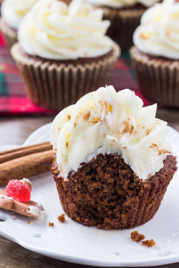 Spiced gingerbread cupcakes that are moist, fluffy & filled with holiday cheer. Then they're frosted with tangy, sweet cream cheese frosting and a sprinkle of cinnamon