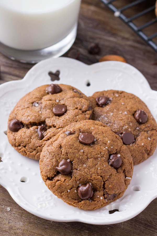 A plate of 3 almond butter chocolate chip cookies.