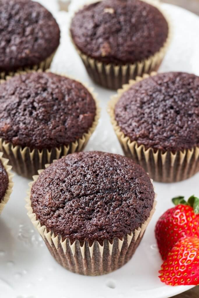 A plate of moist, fluffy chocolate cupcakes.